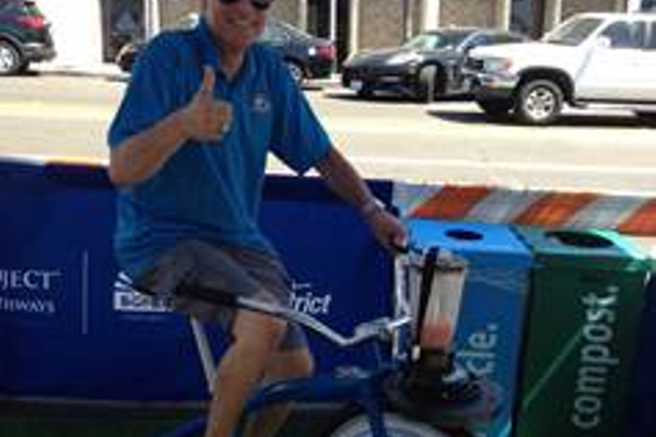 Mayor Wayne Powell churns out a smoothie using a bicycle blender.