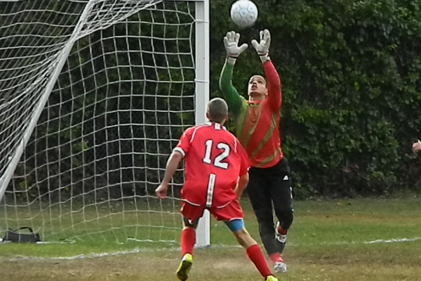 Tewksbury High goaltender Rafael Perez and defender Kyle Paquette (12) have been two of the main reasons that the TMHS boys' soccer team is off to a 4-0-4 start.