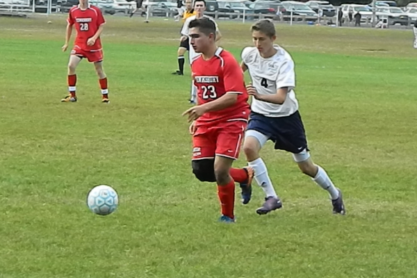 Sophomore midfielder Ameen Kalkhoran presses forward with the ball.
