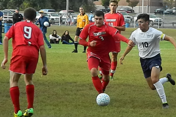 Junior defender Ryan Bain (3) moves the ball into the attacking zone.