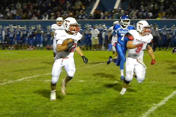 Tom Casey (9) gets out front to block for Troy Carey (22) on a punt return.