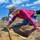Archeologist Amanda Snyder of Lebanon measures a sample hole while documenting the dig. Photo by John  A. Pavoncello.