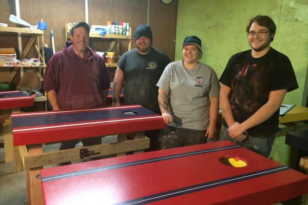 The staff of Wicked Cornhole. From left, Bruce Taylor, Christian Taylor, Amanda Taylor and Justin Hirsch.