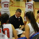 TMHS coach Mark Bradley instructs his players during a time out.