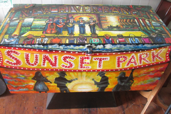 A trunk painted as a tribute to both Sunset Park and the New River Ranch.