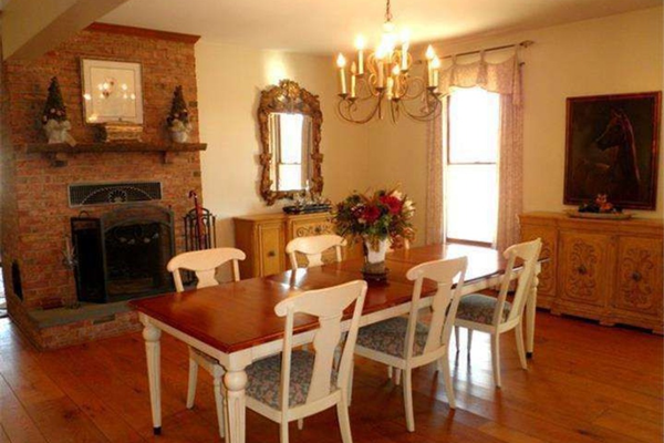 One of the home's three fireplaces is in the spacious dining room.