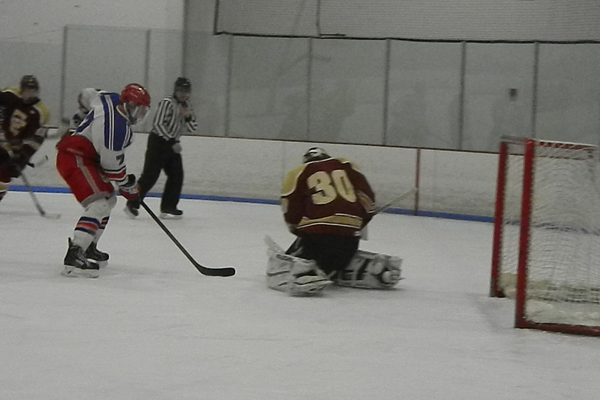 Senior forward Derek Castiglione (7) attacks the net.