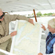 Ralph Hazel, Jr., and his wife Clare look at a map of the region's waterways