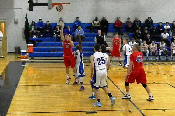 Senior guard Derek McGaffigan (10) goes up for two.