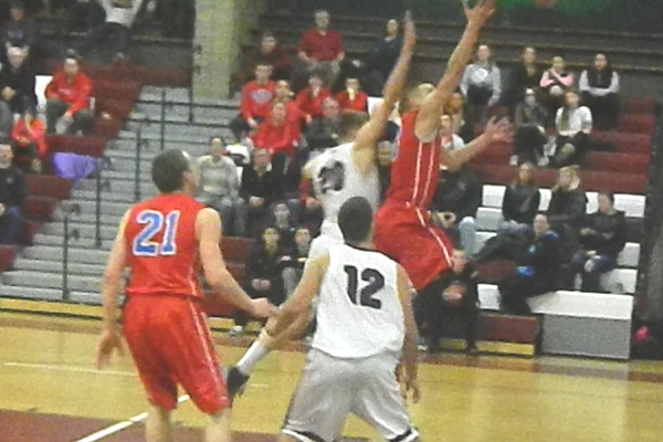Alex DiRocco goes up for two of his 21 points against Chelmsford.