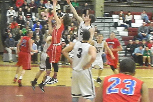 Nate Tenaglia (4) drives the lane for two points against Chelmsford.