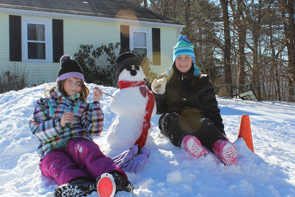 The Kratman girls show off their well-dressed snowman!