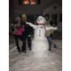 Alyssa, Nick & Dad building Pat the snowman. He's a Patriots fan, too