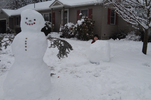 This very friendly snowman waves to drivers going by the Cunningham home.