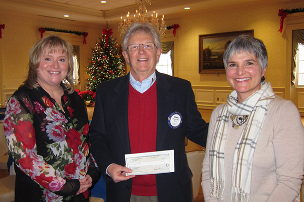 Rotary Club President George Dull presented a $1,000 check to school counselors Sue Douglas at Kerr Elementary and Janet Fazzini at Hartwood Elementary for the program that provides supplemental food for students when they are not in school.