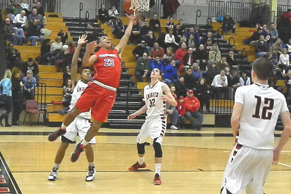 Adam Gajjaoui (23) drives the baseline for two points against North Andover.