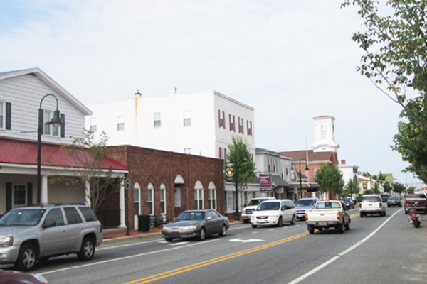 Today, the view looking west on Main Street has changed almost completely, although the steeple is still a landmark.