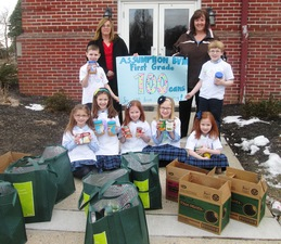 First graders from Assumption BVM School drop off their food donation to The Bridge on Feb 6