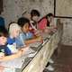 """Courtesy photo As a part of """"School Days,"""" students experience an 18th century schoolroom by participating in lessons using quill pens, slates, and chalk."""