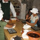 Courtesy photo In one workshop, children get to work with leather to make their own book bag tags.