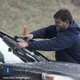 A motorist pulls to the side of I-75 North in Knoxville to clear ice from his windshield.  HKI Photo: Robert Berlin