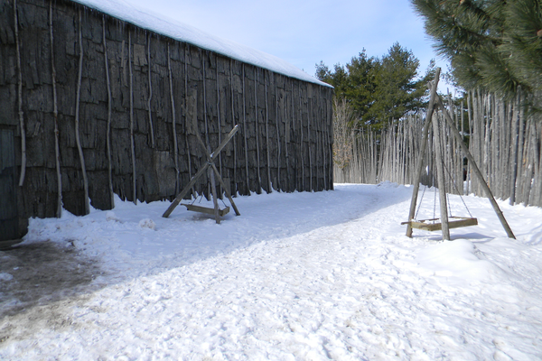 A 15th-Century Iroquoian Village was reconstructed on its original site in Ontario, Canada. It is similar in size to the Montoursville Boro Site longhouse excavated in the 1960s.  Photo courtesy of Laslovarga, Wikimedia Commons.