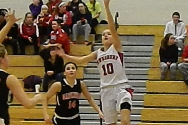 Emily Velozo (10) drives the baseline for two.
