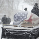 A horse-drawn caisson waits to carry Pinter through heavy snow flurries to Veterans of Bordentown Cemetery.