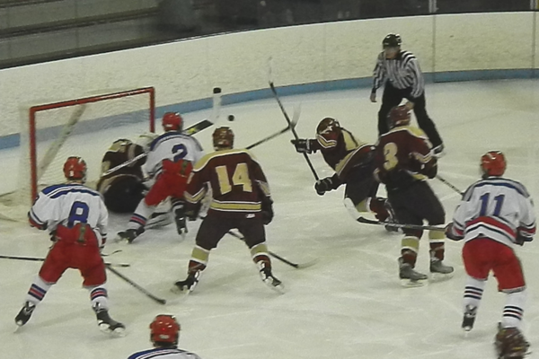 Scramble in front of the Concord-Carlisle net -- still no goals.