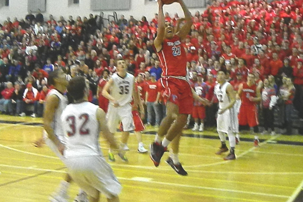 Adam Gajjaoui (23) powers his way to the basket.