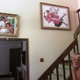 The foyer of the Dixon house features Luis Soler's painting 'Fairy Tales' (left), Robert Sarsony's 'Conversation' (center) and Carrie Quade's ceramic sculpture 'Beth Beckonstance' (right).