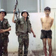 """A Viet Cong prisoner caught hiding during """"Mini Tet"""" in Saigon. (Photo by Bryan Grigsby.)"""