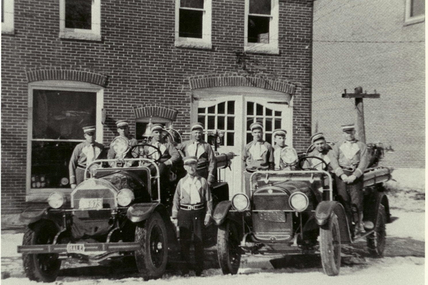 Fire company officials with the 1930 Reo Hale.