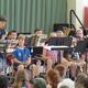 Fifth grader Alek Cranston demonstrates the alto saxophone during the Ryan School Band Tour.