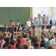 Band Director Tim Olevsky addresses third and fourth graders at the North Street School. Mr. Olevsky explained the many opportunities for students to play instruments at the Ryan School and participate in the band.