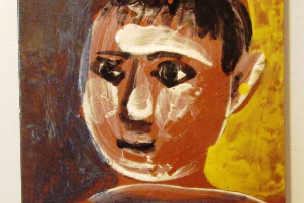 'Tete d'enfant' by Pablo Picasso, a painting on a tile.