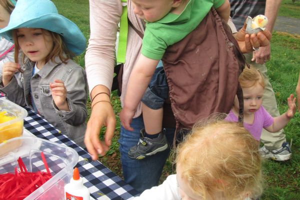 Children take part in craft stations offered at the farm during the May grand opening celebration.