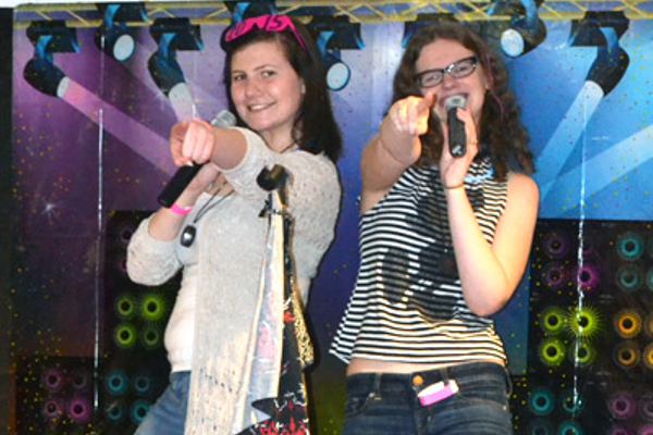 Justine Keeler and Katelyn Burchill are rocking karaoke on the stage
