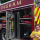 Bellingham first grader Gigi poses by the Bellingham fire truck.