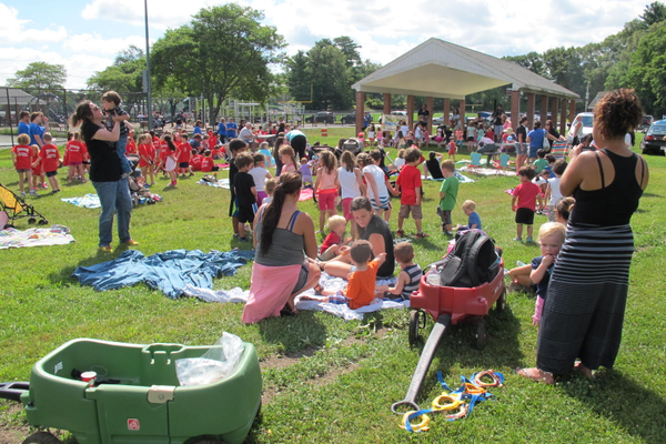 An enthusiastic crowd enjoys the Summer Concert at Livingston Street