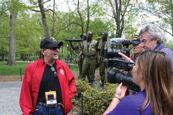Vietnam Veteran John Anthony D'Angelo of Manteca chats with reporters at the Vietnam Veterans Memorial. Photo by Bud Elliott.