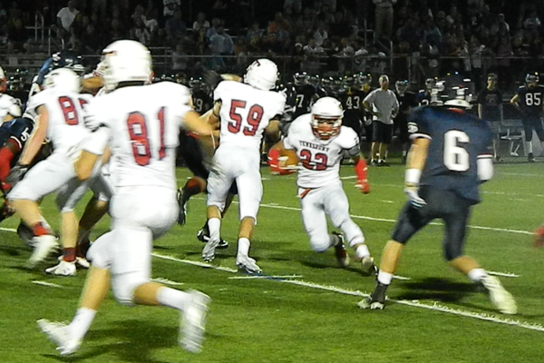 Troy Carey (22) got plenty of blocking from Steven Ctanzano (81) and Stephen Bonugli (59)