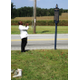 A member of the Singing and Praying Bands of Maryland and Delaware takes a photo of the historic marker in front of Hosanna Church.