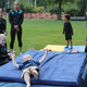Students of Marcov Sharp Gymnastics help with somersaults.