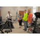 Police Chief Gerry Daigle shows visitors the exercise equipment that his staff will use.