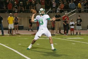 Mason Holmes drops back to pass during a 38-37 Dragons victory over Coppell Photo by StewartSnappedDragonscom