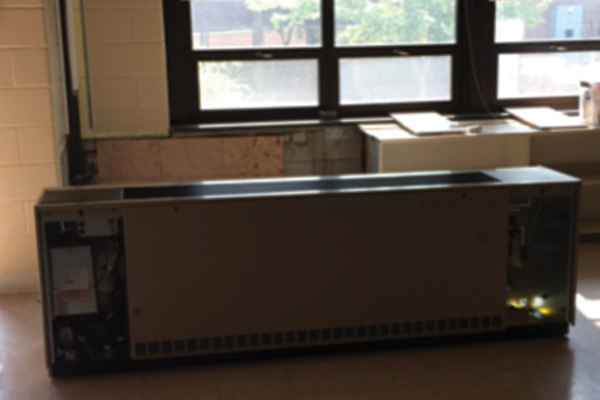 The classroom receives new duct work and heating elements.