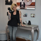 Stacy Larsen poses with her camera collection