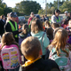 """Safe Routes to school coordinator Suzanne Walton hands out """"I walked to school"""" stickers to children who participated in the fall event."""