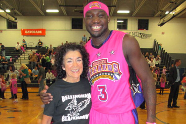 Elementary school art teacher Maria Eydenberg with forward Dexton Williamson